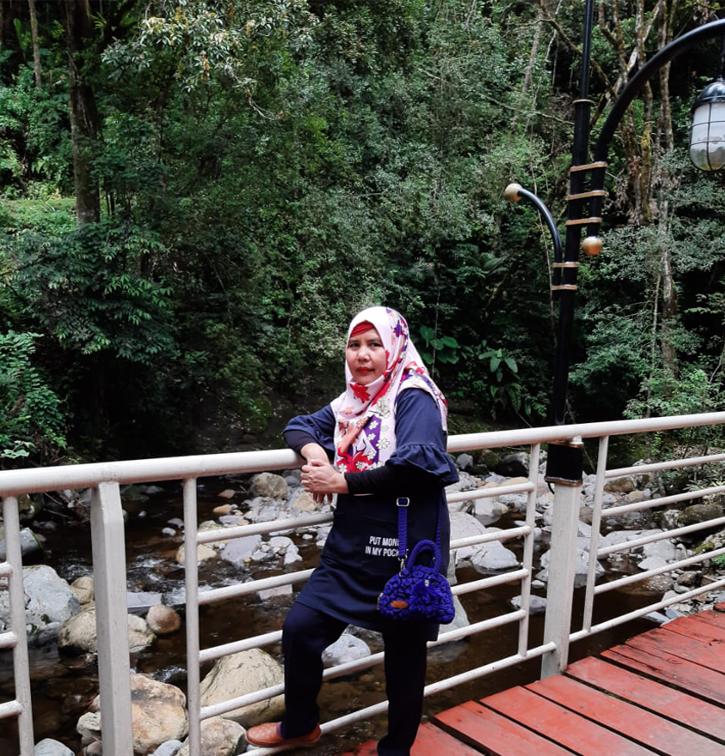Dra. Siti Hanisah